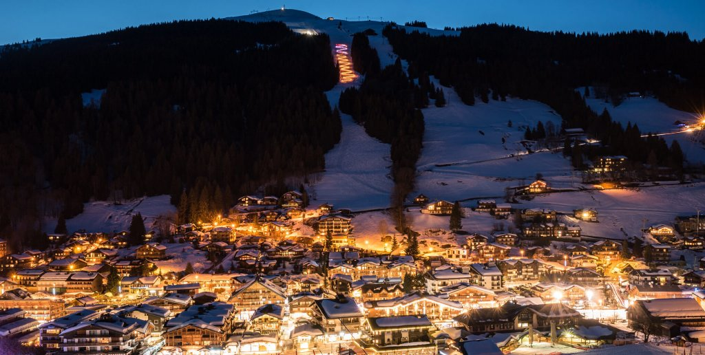 Torchlight descent in Les Gets winter
