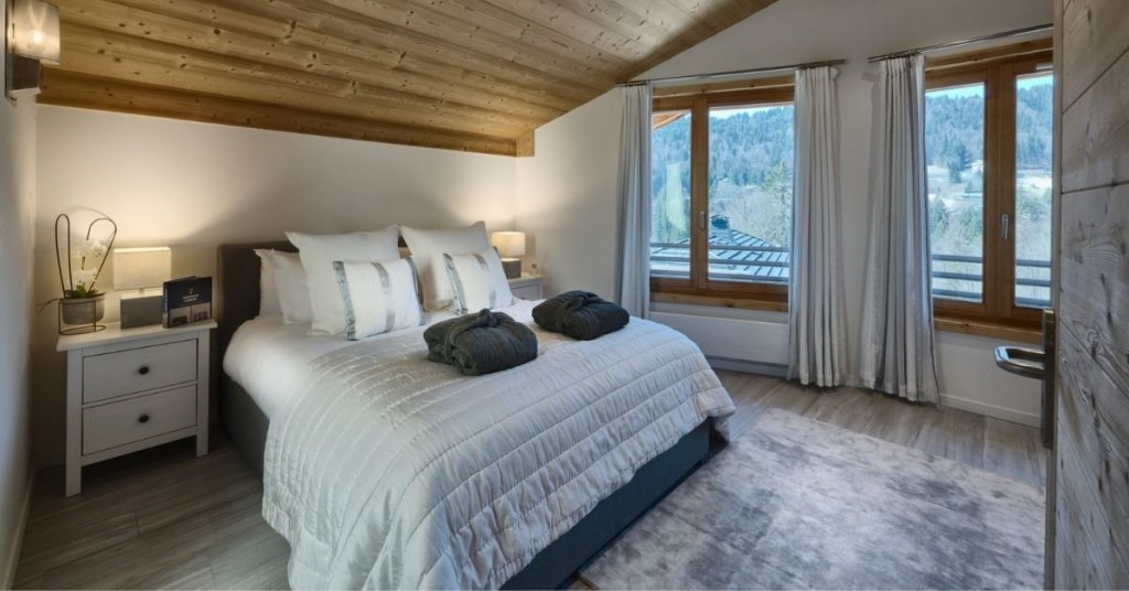 Chalet Blanc bedroom featuring panoramic views of French mountain ranges