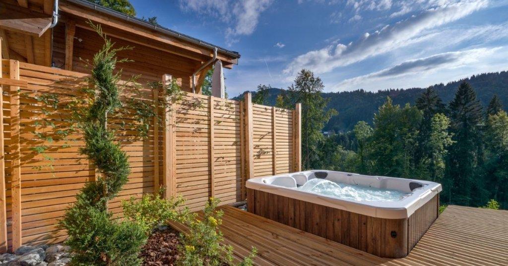 Chalet Lorne hot tub featuring scenic views of Parc des Dérêches
