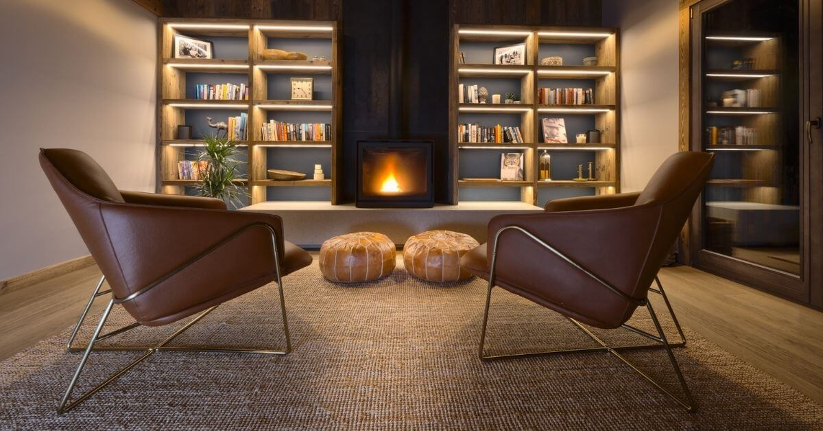 Recoup and relax in front of Chalet Vesper's modern fireplace