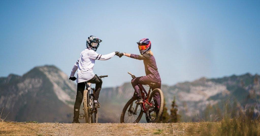 Two teenagers mountain biking